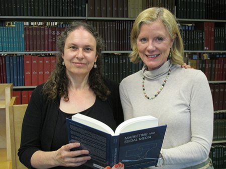 Dr. Lorri Mon and Dr. Christie Koontz show off their new book.