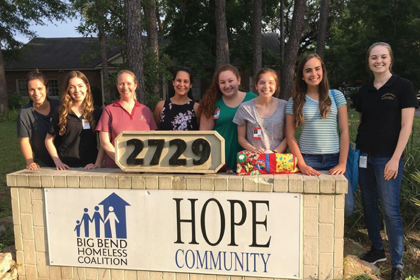 Students with Dr. Hall-Mills at HOPE Community Center