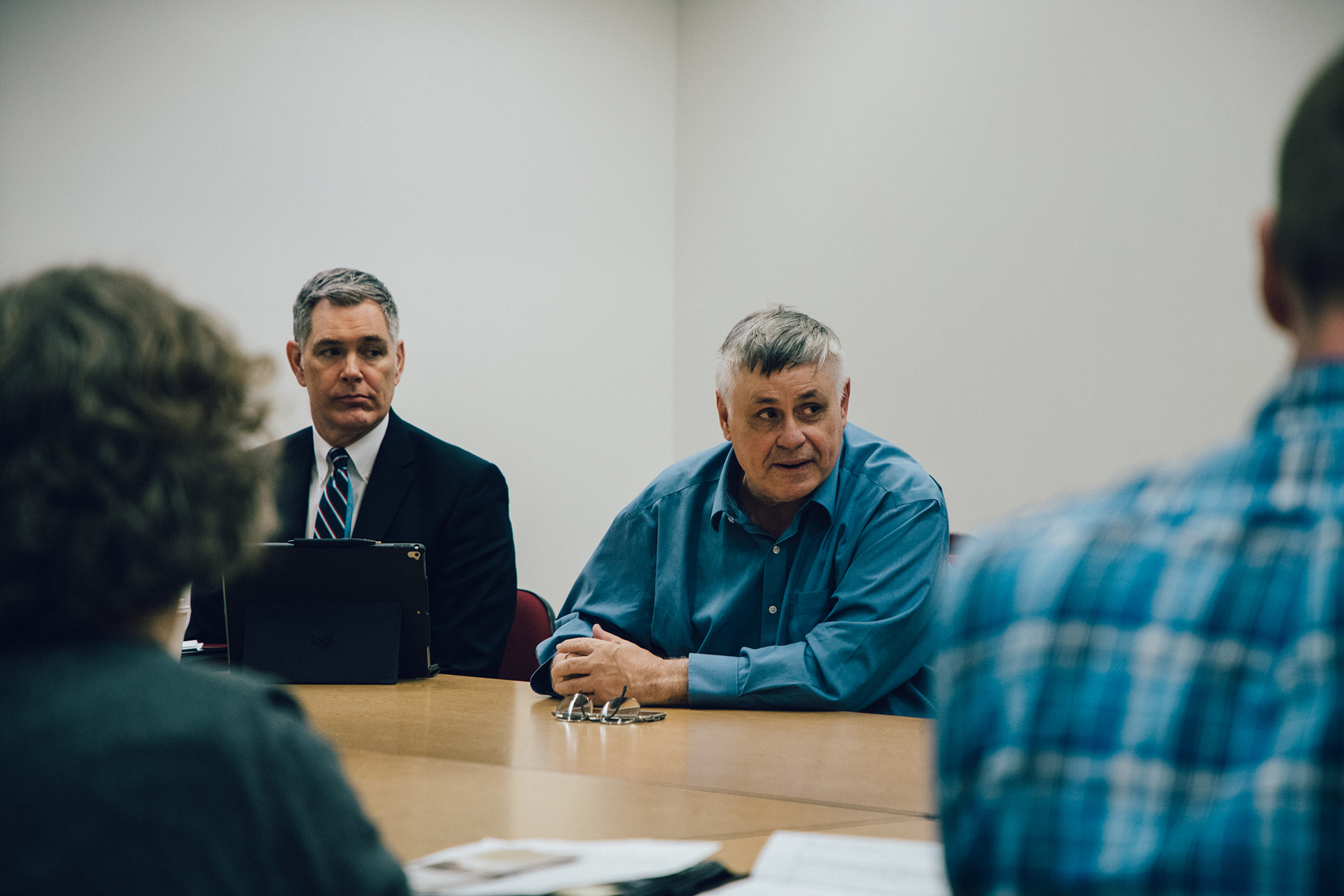Dean Tom Reichert and Dean Larry Dennis sit in a group discussion