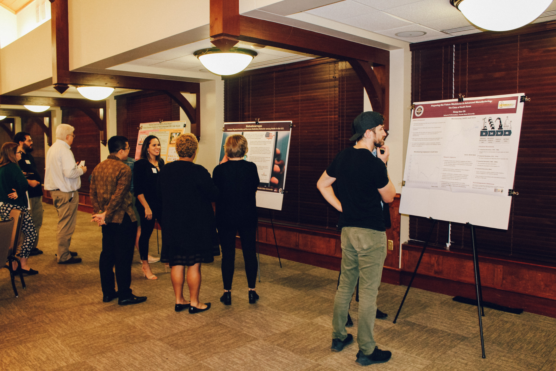 Students presenting research posters at the 2019 CCI doctoral poster session