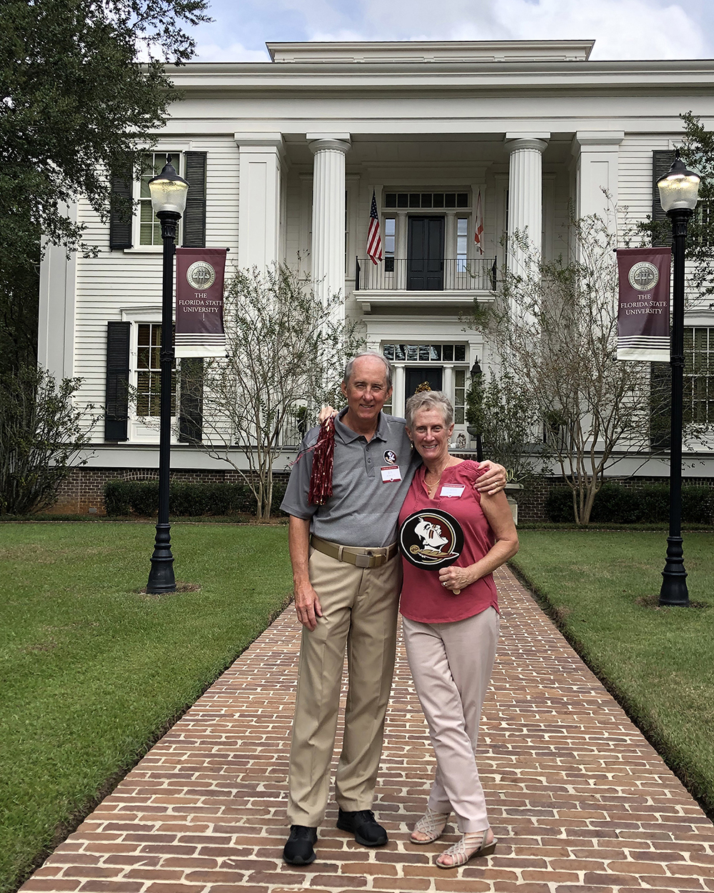 Jeff and Cathy Hewlett in front of the FSU President's House