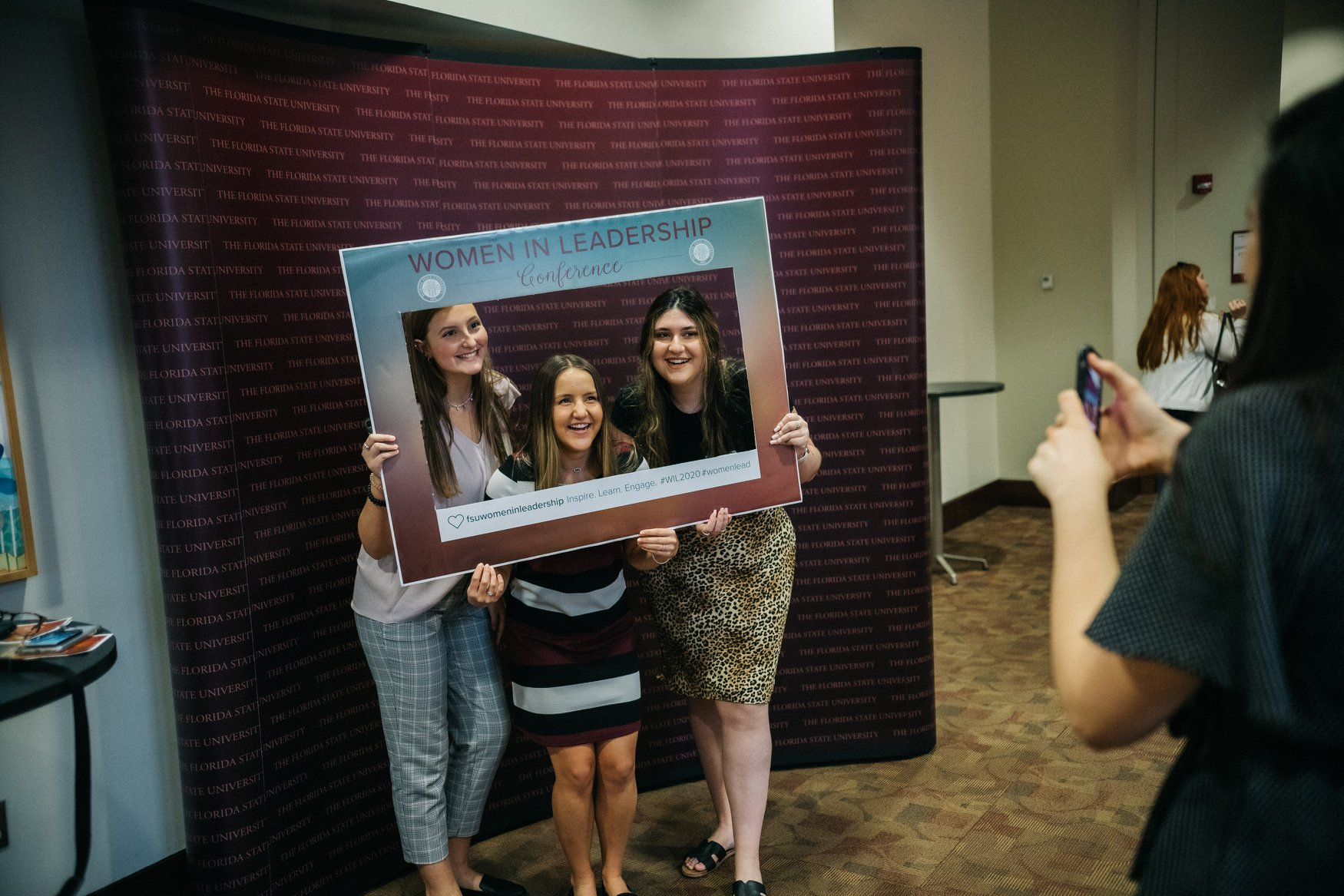 Attendees at the Women in Leadership conference gather for a photo