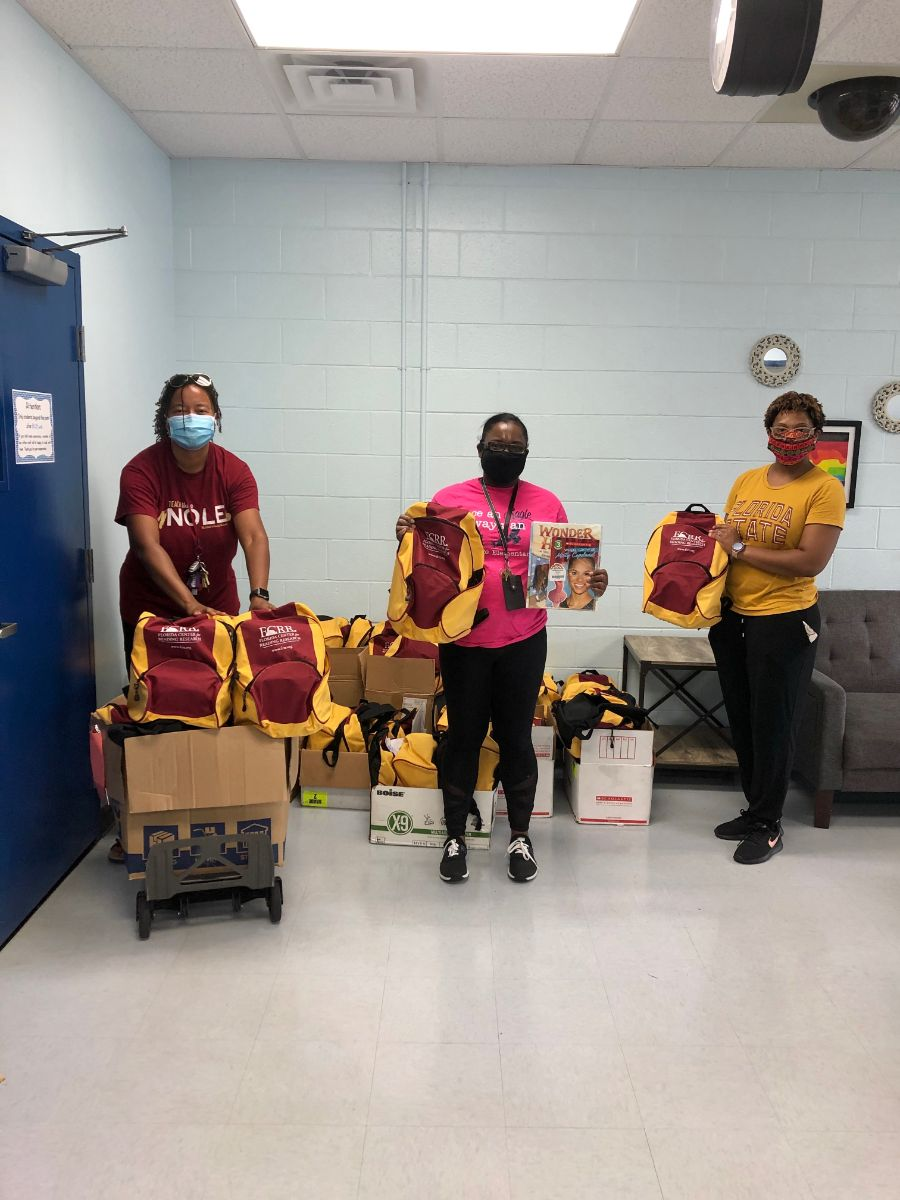 Lakeisha Johnson with bookbag donations