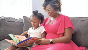Lakeisha Johnson and her daughter Maya Johnson, 5, read a book together in their home.